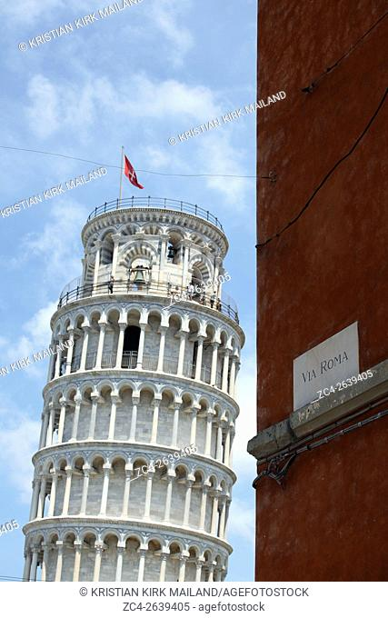 Leaning Tower of Pisa seen from via Roma. Italy