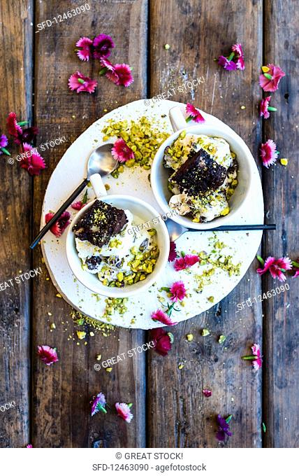 Brownie and pistachio ice cream in small bowls