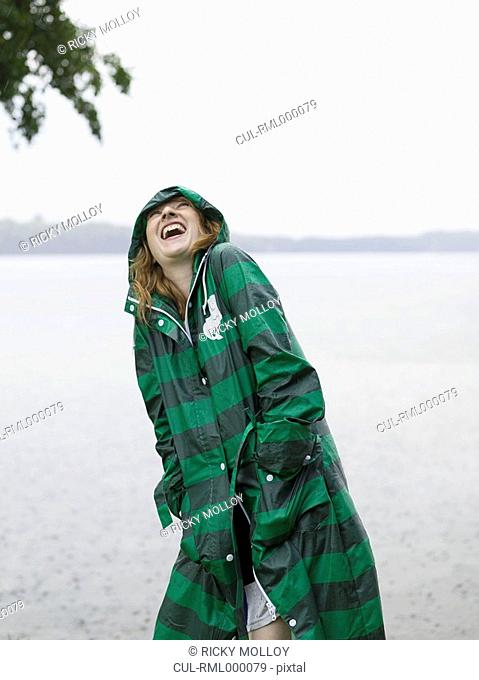 Woman with raincoat on in the rain