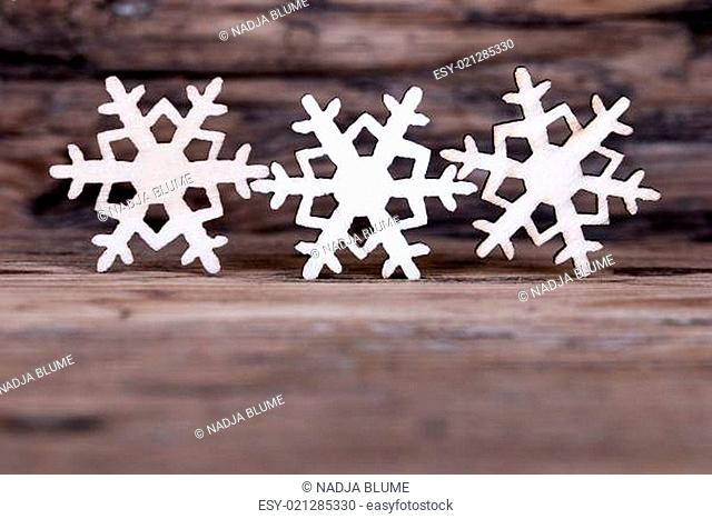 Some Snowflakes on Wood I