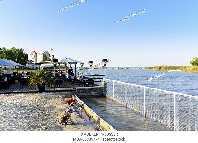 Restaurant at the lake Neusiedl, in the background a scenery of the sea festival, Austria, Burgenland, Mörbisch at the lake