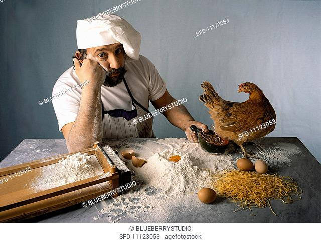A chef waiting with a chicken