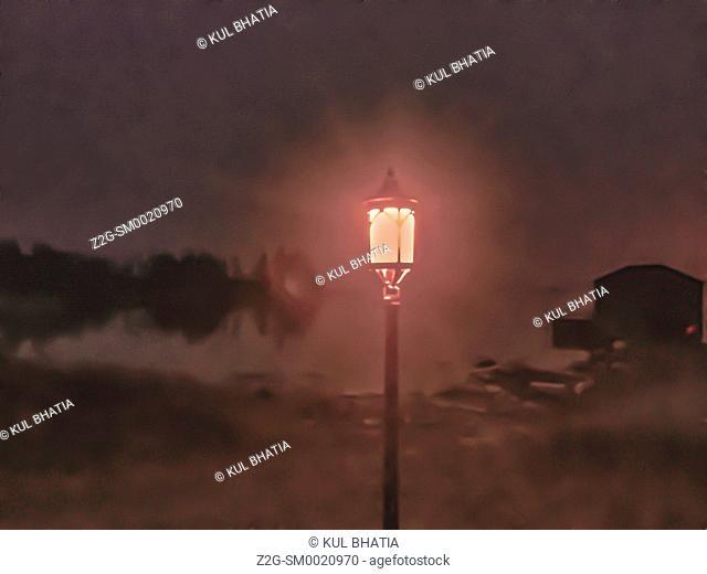 A single light post casts a soft light on a cove in the Atlantic Ocean, Halifax, Nova Scotia, Canada