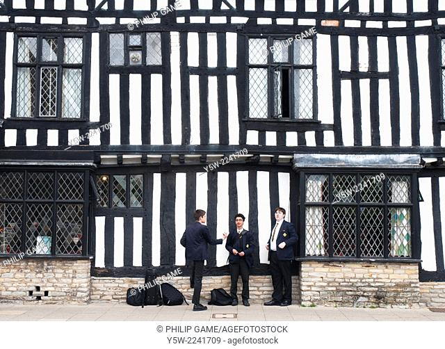 Schoolboys waiting outside the Falcon Hotel in Stratford-upon-Avon, England