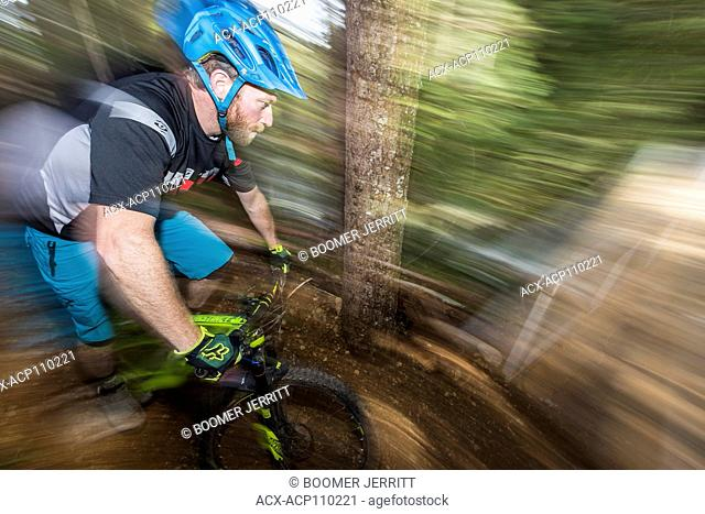 A motion oriented mountain biker prepares to cross the newly built Sykes Bridge while riding on one of the many mountian bike trails in the Cumberland area