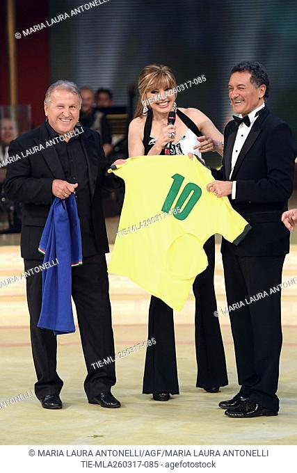 The former football players Arthur Antunes Coimbra ' Zico ' and Claudio Gentile exchanging the shirts of Brazil and Italy with Milly Carlucci during the tv show...
