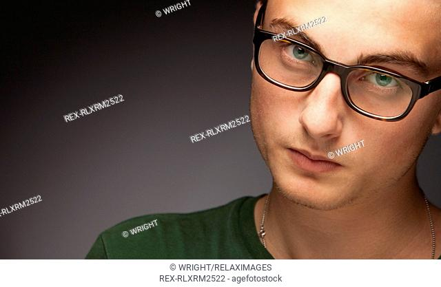 Teenager boy man serious clever glasses portrait
