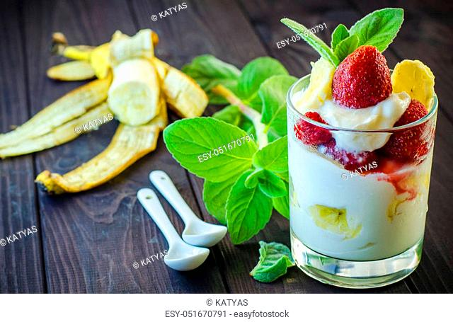 Milk dessert with strawberry and banana closeup