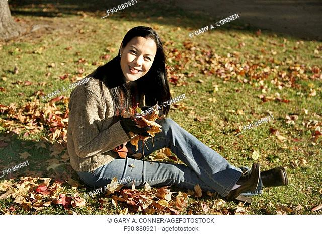 Young woman w autumn leaves MR