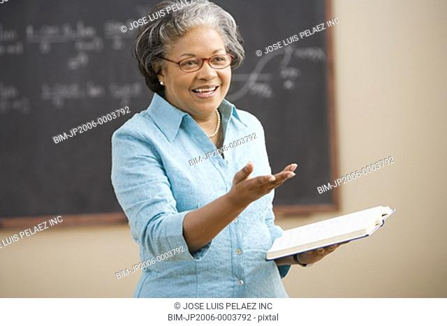 Senior African female teacher lecturing