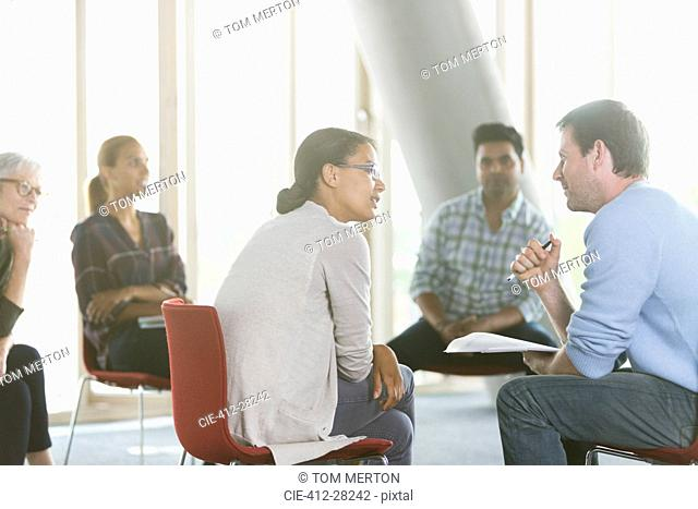 Business people discussing paperwork in meeting