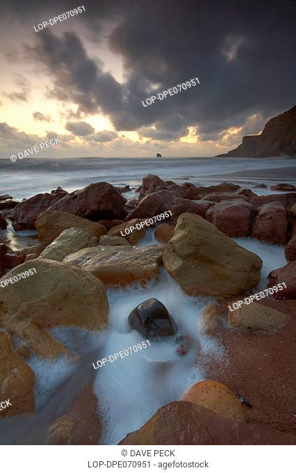 England, North Yorkshire, Saltwick Bay, Pools of water forming inbetween rocks on the beach at Saltwick Bay