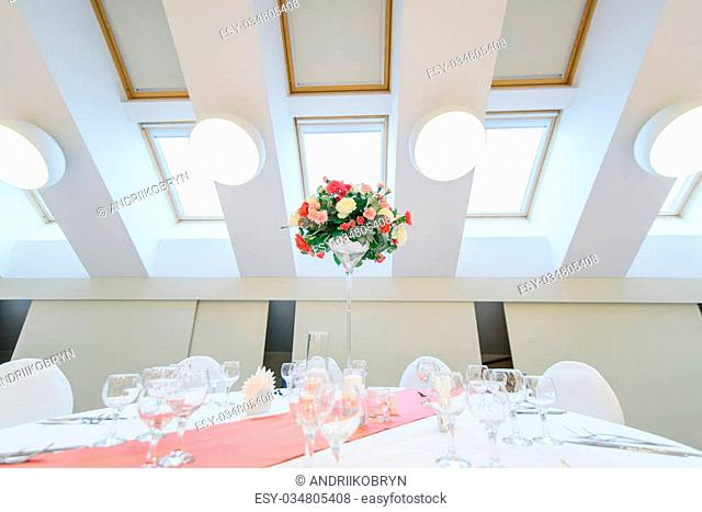 Charming bouquet of roses on a table in luxury modern restaurant