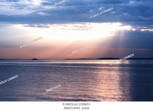 Sunset rays over the ocean landscape background hd
