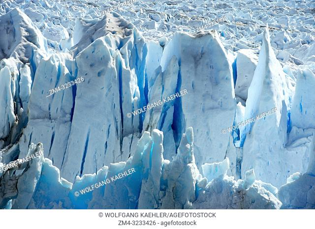 View of backlit crevasses of the Perito Moreno glacier at Lago Argentino in Los Glaciares National Park near El Calafate, Patagonia, Argentina