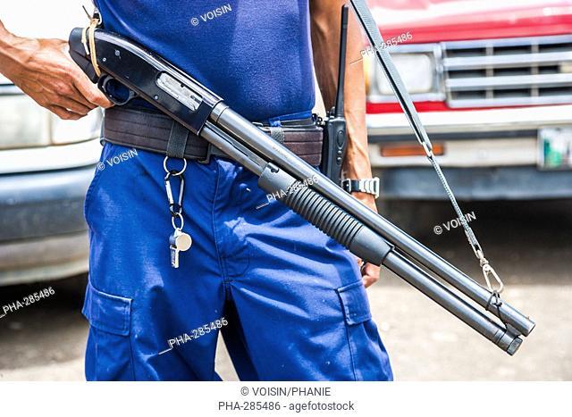 Man wearing a gun