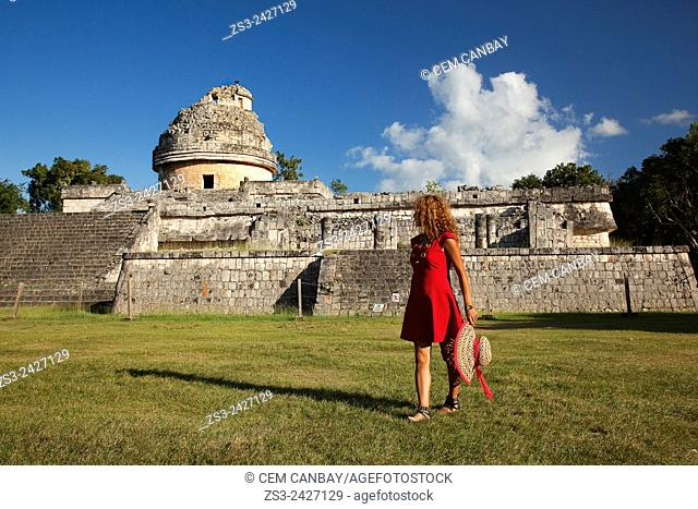 Woman posing in front of the El Caracol in Chichen Itza Ruins, Chichen Itza, Yucatan Province, Mexico, Central America