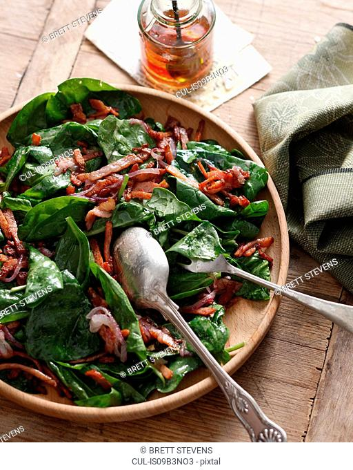 Spinach and bacon salad with red wine vinaigrette, close-up