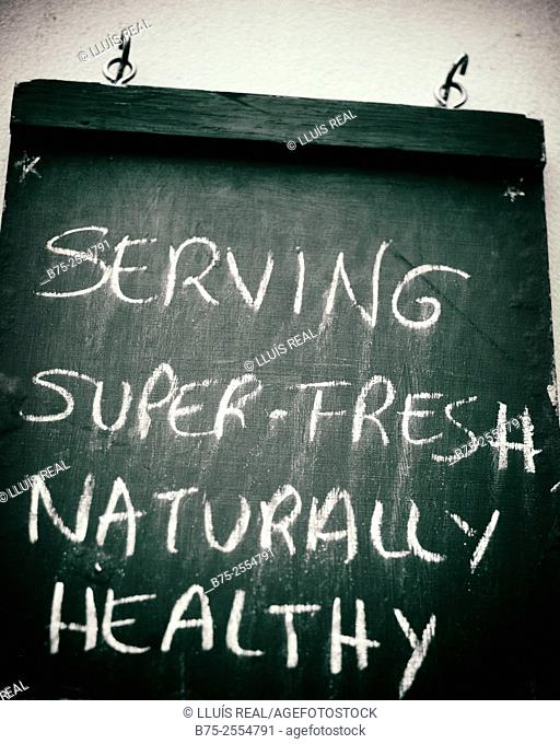 Blackboard announcing Serving Super-Fresh Naturally Healthy. England, UK