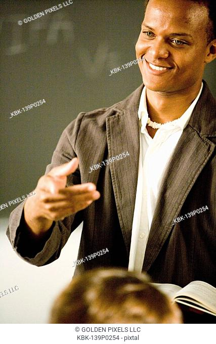 Teacher gesturing to students in the classroom