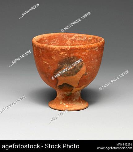 Terracotta footed cup. Period: Early Minoan II; Date: ca. 2600-2200 B.C; Culture: Minoan; Medium: Terracotta; Dimensions: H. 3 11/16 in. (9