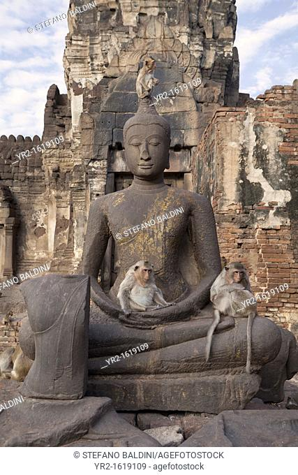 Ancient Buddha statue at Phra Prang Sam Yot, the Khmer temple in the old town of Lopburi, Central Thailand, Asia