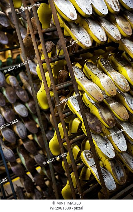 Close up of various metal shoe forms in a shoemaker's workshop