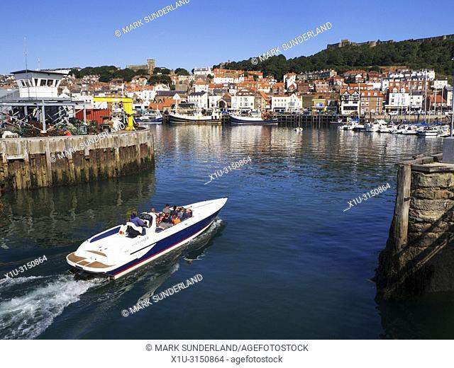 Speedboat ride returning to the harbour at Scarborough North Yorkshire England