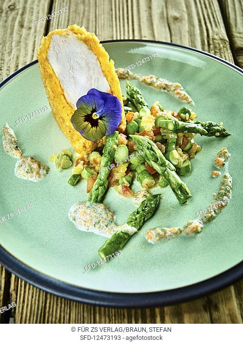 Roast chicken coated in cornflakes with green asparagus and flaxseed