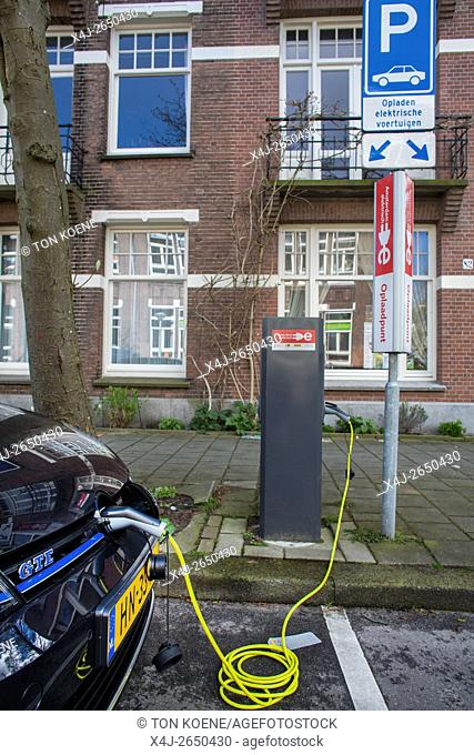 electrical car at charging point in Holland