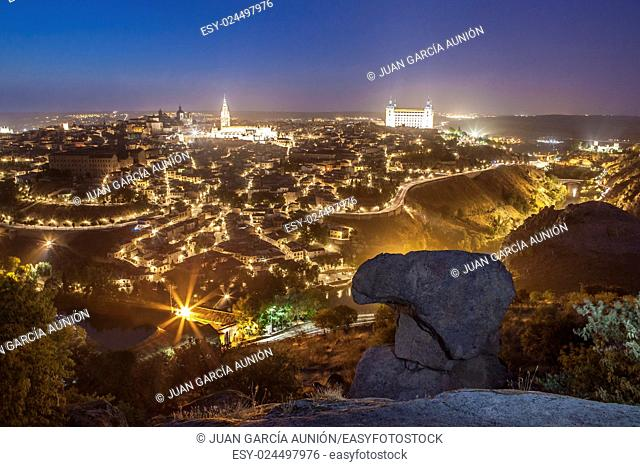 Old town cityscape with Alcazar and Cathedral at night, Toledo, Spain