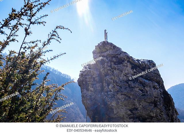 Italy, Lombardy, Varese, statue of the most holy Virgin Mary over a rock, bathed in rays of sun from the sky
