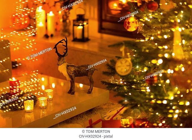 Reindeer decoration in ambient living room with candles and Christmas tree