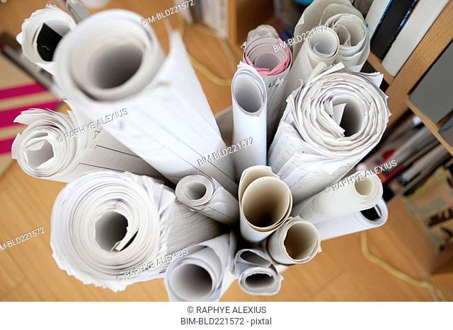 Rolls of blueprints in basket