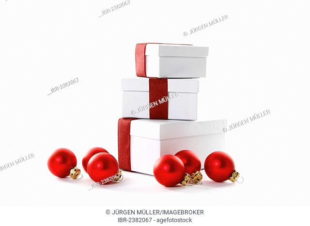 Red Christmas baubles and presents with red ribbons