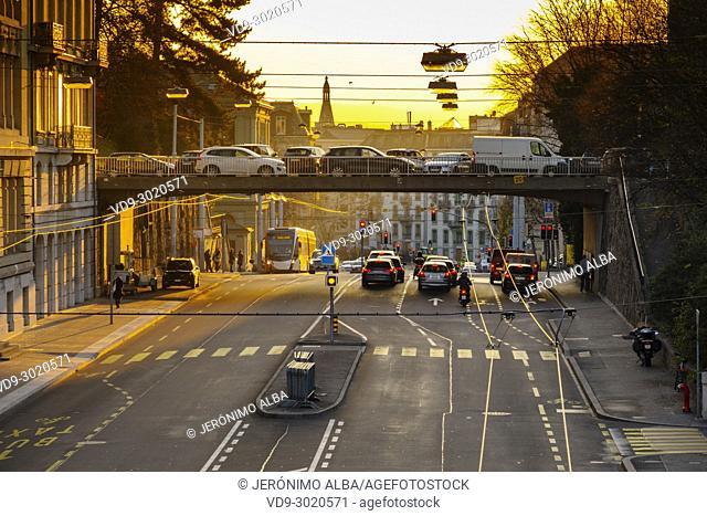 Boulevard Helvetique, traffic car scene at sunset. Old town, historic center. Geneva. Switzerland, Europe