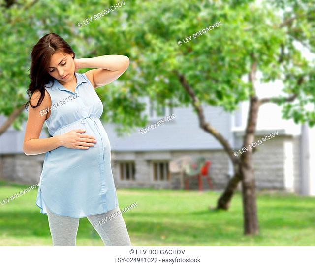 pregnancy, health, people and expectation concept - pregnant woman touching her neck and suffering from ache over summer garden and house background