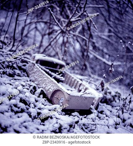 discarded and decaying vacuum cleaner, snow, Czech Republic