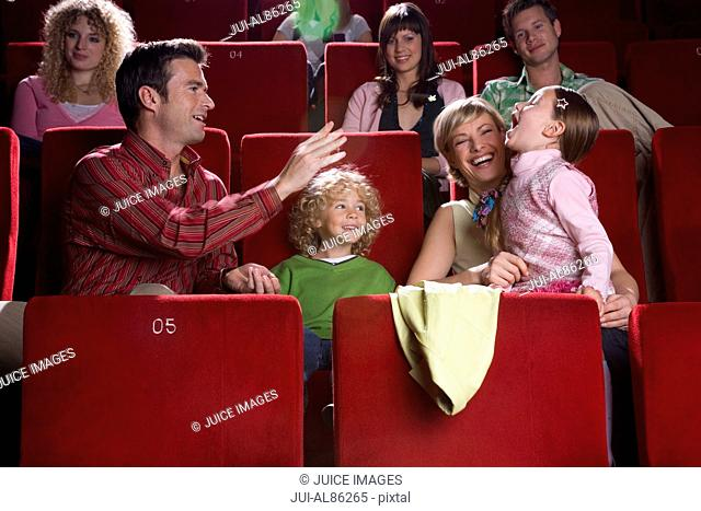 Family being silly in movie theater