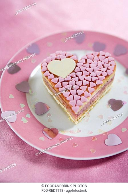 Heartshaped pink cake on plate
