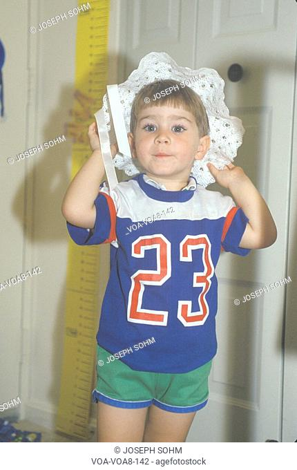 A pre-school boy wearing a bonnet in Washington, D.C