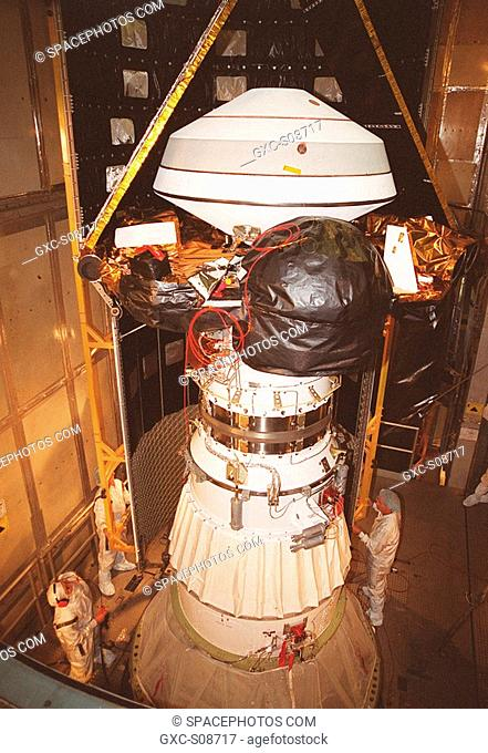 07/25/2001 -- Inside the mobile service tower at Launch Complex 17-A, Cape Canaveral Air Force Station, the Genesis spacecraft waits for the first half of the...