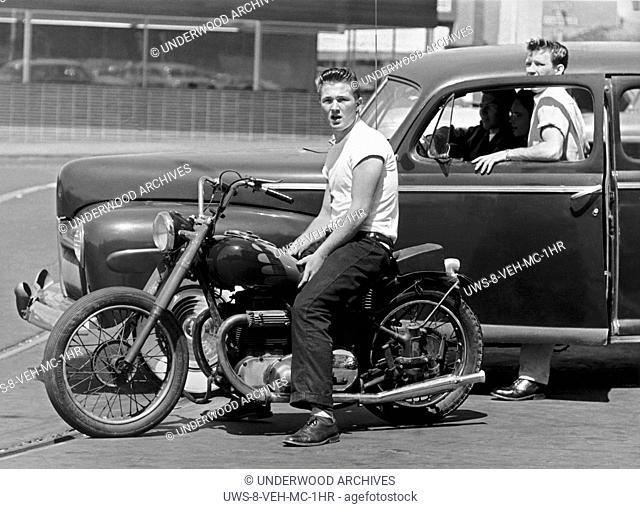 San Francisco, California: c. 1954.Youths hanging out with their motorcyle and car