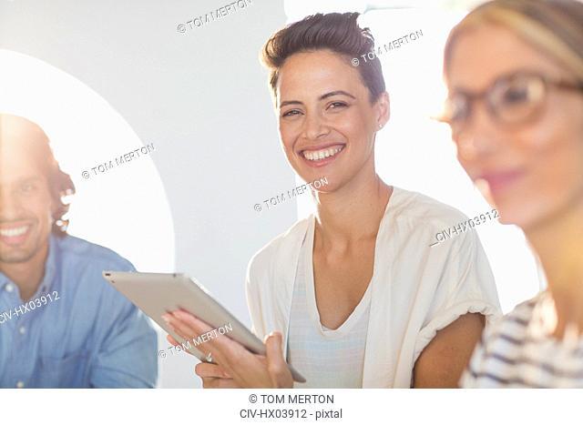 Portrait smiling, confident businesswoman using digital tablet