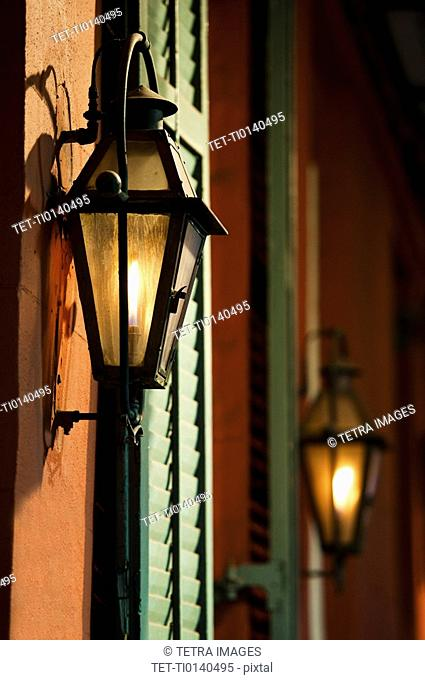 Lanterns on wall of building in French Quarter of New Orleans