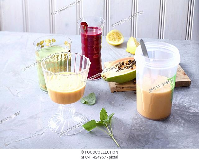 Various shakes and ingredients on a grey surface