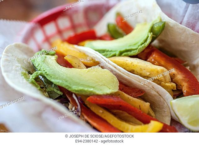 Vegetable tacos in a basket in a restaurant