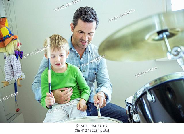 Father and son playing drums together