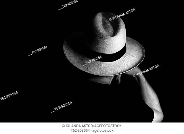 Woman with Panama hat, resting, on its back