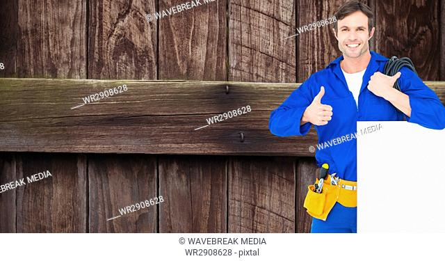 Repairman with bill board showing thumbs up sign